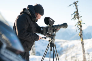 Paul Watt filming with the RED Weapon 8K and Sigma 150-600mm Sport in the backcountry.